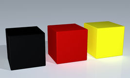 Cubes. Shiny black, red and yellow  cubes Royalty Free Stock Images