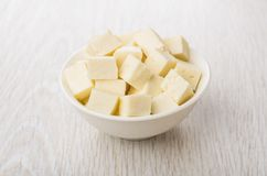 Cubes of soft cottage cheese in white glass bowl Stock Images