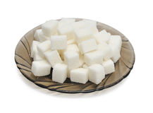 Cubes of sugar on the black plate Royalty Free Stock Photo