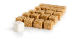 Cubes of sugar cane brown and white refined Stock Photos