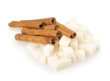Cubes of sugar and cinnamon Royalty Free Stock Photos