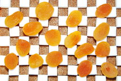 Cubes of sugar  and dry apricots Royalty Free Stock Images