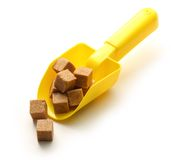 Cubes of sugar with spoon Stock Images