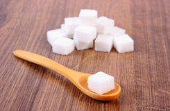 Cubes of sugar on wooden background, ingredient for cooking Royalty Free Stock Images
