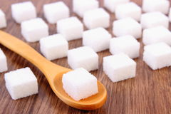 Cubes of sugar on wooden background, ingredient for cooking Stock Image