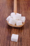 Cubes of sugar on wooden background, ingredient for cooking Stock Photos