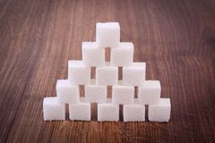 Cubes of sugar on wooden background, ingredient for cooking Royalty Free Stock Photography