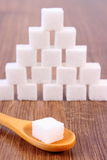 Cubes of sugar on wooden background, ingredient for cooking Royalty Free Stock Image