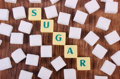 Cubes of sugar on wooden background, ingredient for cooking Royalty Free Stock Photo