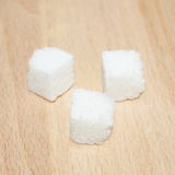 Cubes of sugar  on wooden plate Stock Photo