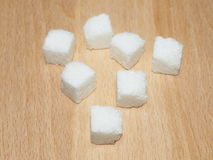 Cubes of sugar  on wooden plate Royalty Free Stock Photography