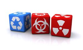 Cubes with symbols. Three cubes with symbols or labels including recycling, virus and hazardous or radioactive Royalty Free Stock Image