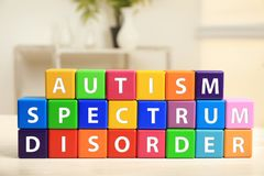 Cubes with text AUTISM SPECTRUM DISORDER. On table Royalty Free Stock Image