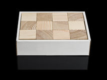 Cubes from a tree in a cardboard box Stock Photography