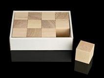 Cubes from a tree in a cardboard box Royalty Free Stock Image