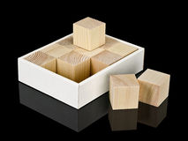Cubes from a tree in a cardboard box Royalty Free Stock Images