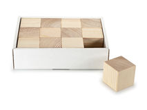 Cubes from a tree in a cardboard box Stock Photos