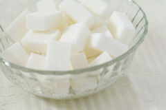 Cubes of white sugar in a crystal bowl Stock Photo