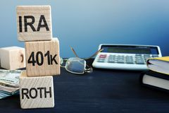 Cubes with words IRA, 401k and ROTH. Retirement plan. Concept royalty free stock images