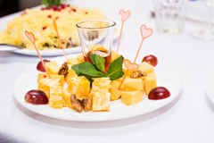 Cubes of yellow cheese Stock Images