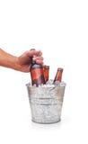 Cubeta da cerveja com mão Fotografia de Stock Royalty Free