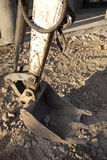 Cubeta da máquina escavadora da lagarta Foto de Stock Royalty Free