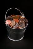 Cubeta das moedas Imagens de Stock