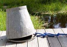 Cubeta de água na ponte foto de stock royalty free
