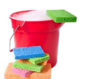 Cubeta e esponjas Fotografia de Stock