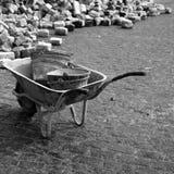 Cubetas no wheelbarrow imagem de stock