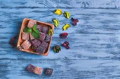 Cubi della gelatina della marmellata d'arance della bacca Fotografie Stock