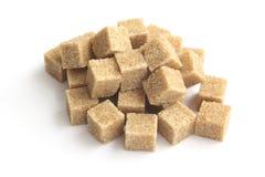 Cubi dello zucchero di Brown Immagine Stock
