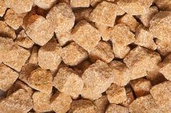 Cubi dello zucchero di canna marrone, struttura Immagini Stock