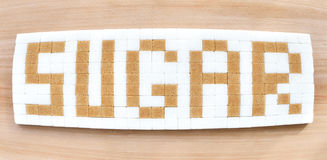 Cubi dello zucchero nel formato di testo Fotografie Stock