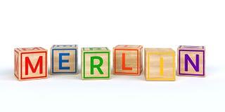 Cubi di legno isolati del giocattolo con le lettere con il nome MERLIN royalty illustrazione gratis