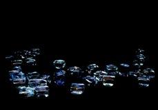 Cubi di vetro sul nero Immagine Stock Libera da Diritti