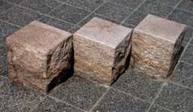 Cubic stones geometry. Some cubic stone sits in a Japanese park Royalty Free Stock Images