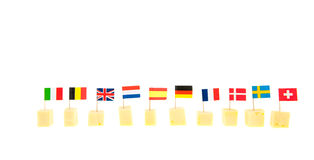 Cubica el queso con las banderas Foto de archivo libre de regalías