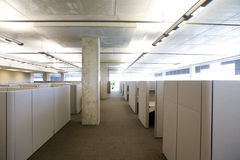 Cubicle setup in a modern clean office setting. Hallway view of office cubicle setup in a modern clean office setting Royalty Free Stock Photography