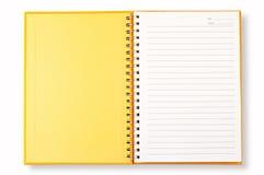 Cubierta amarilla del cuaderno abierto Foto de archivo