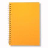 Cubierta amarilla del cuaderno cercano Imagen de archivo libre de regalías