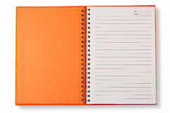 Cubierta anaranjada del cuaderno Imágenes de archivo libres de regalías