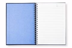 Cubierta azul del cuaderno abierto Fotografía de archivo libre de regalías