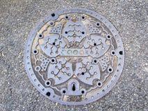 Cubierta de boca combinada del sistema de aguas residuales, sala de Minato, Tokio foto de archivo libre de regalías