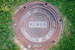 Cubierta de la alcantarilla de la boca de la ciudad de Houston Fotos de archivo libres de regalías