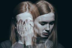 Cubierta de la muchacha su cara Fotografía de archivo libre de regalías