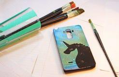 Cubierta pintada para el teléfono celular imagenes de archivo