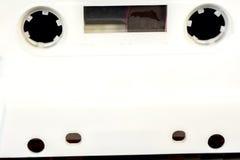 Cubierta plástica blanca del casete con los agujeros Foto de archivo libre de regalías