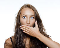 Cubierta sorprendida de la muchacha su boca Foto de archivo libre de regalías