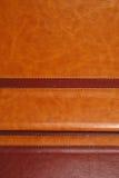 Cubiertas del cuero de Brown con los stiches Imagenes de archivo